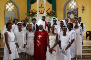Bishop Vincent Darius, parish priest Fr Michael Opoku (back row, centre), catechists and the newly confirmed.