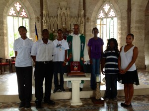 Young Bible readers with Msgr. Harcourt Blackett